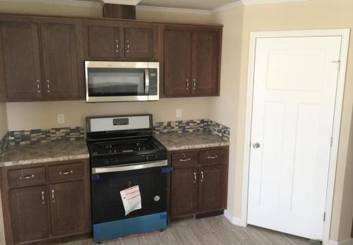 Kitchen with Gas Range and Space Saver Microwave