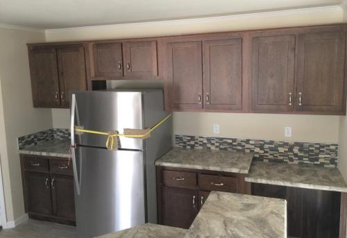 Kitchen with Stainless Appliances Built in Desk