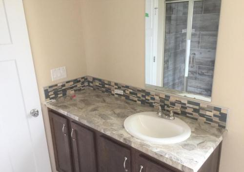 Master Bath with Her Vanity and Walk-In Tile Shower