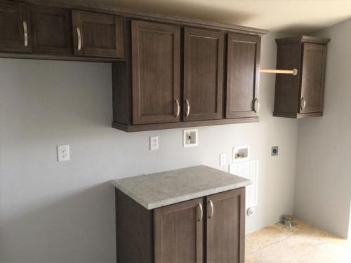 Utility Room with Freezer space and Washer & Dryer hook-ups