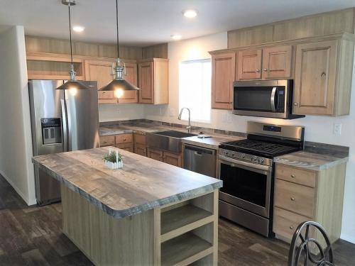 Kitchen Island and Stainless Appliances with Farm Sink